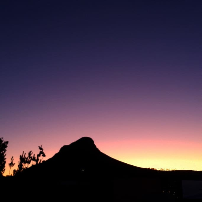 Sunset over Lion's head from our patio- a great climb with views of entire city