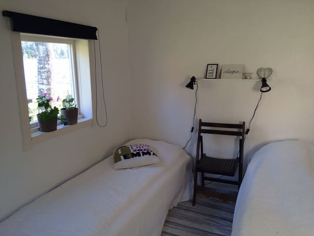 Smallest bedroom in a separate guest house just by the lake
