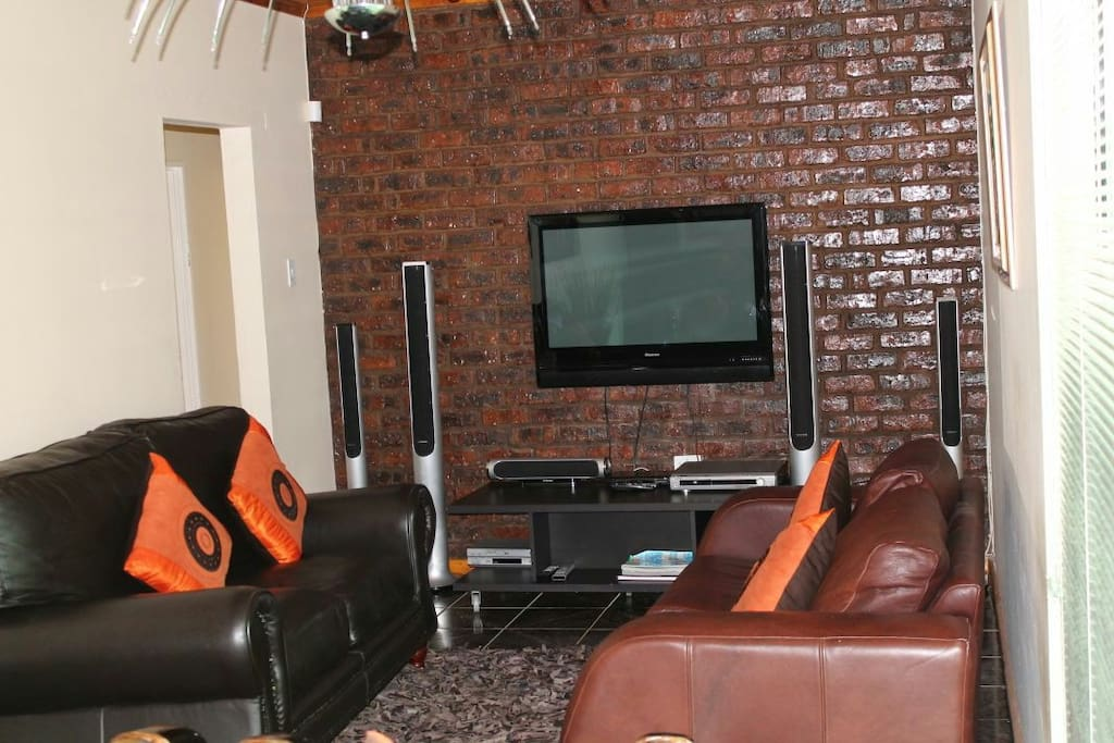 Lounge with TV(DSTV) and sound system.