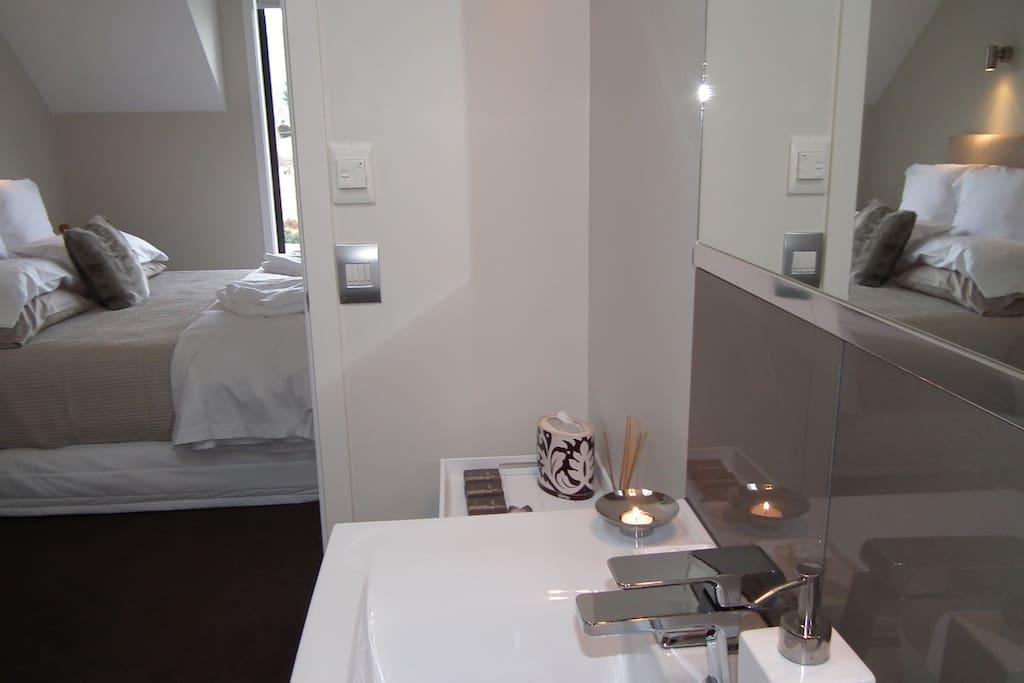 """Ensuite bathroom towards """"Luxurious King Bed"""""""