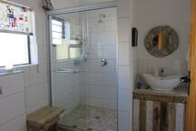 Very spacious Shower. Towels provided.