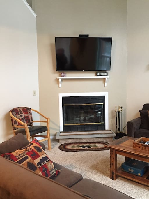 Wood Burning Fireplace and Wall Mounted Internet TV