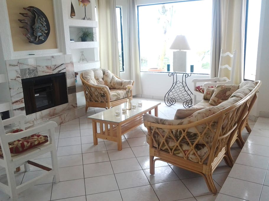 Comfortable large living room with ocean views, fireplace/heater, and TV with Blue Ray/DVD player. Large windows and high ceilings give this room lots of light and great ocean view