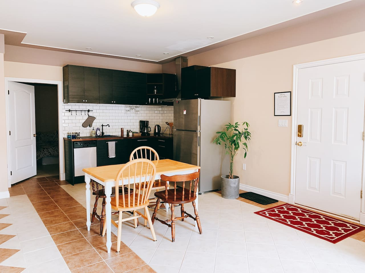 Open plan kitchen with dining table and 4 chairs.
