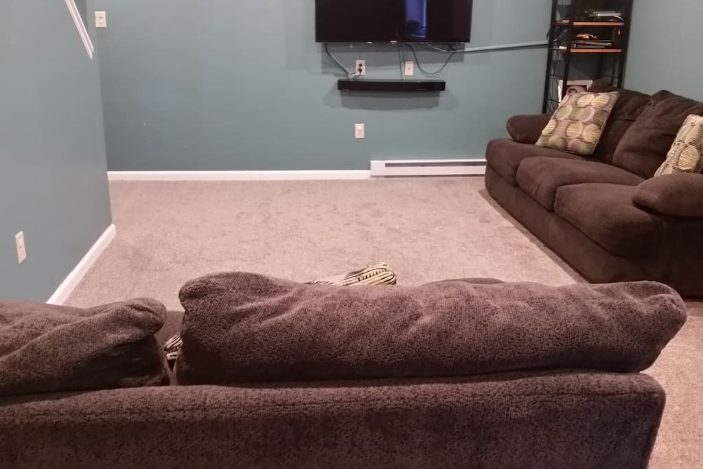 Finished basement with a couch and loveseat. Can sleep 2. 50 inch TV.