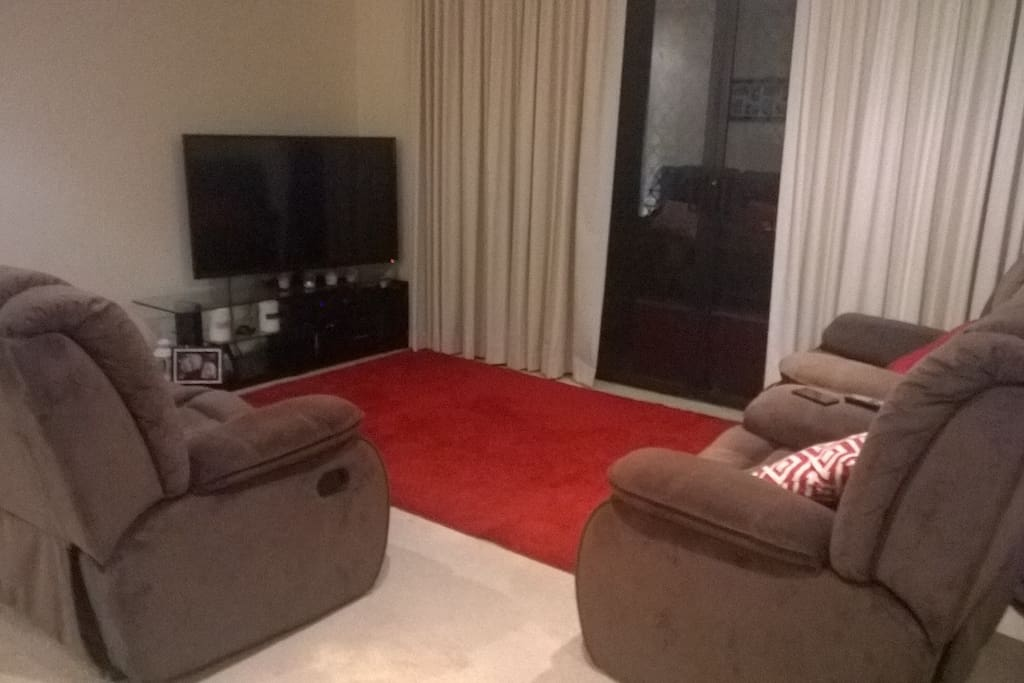 Living Room Area. Large 55inch TV with Foxtel cable.