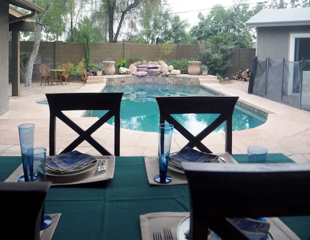 This table for 6 (squeeze 8) is under cover and pool side. With easy access to the kitchen, like us, you'll probably enjoy most meals there!