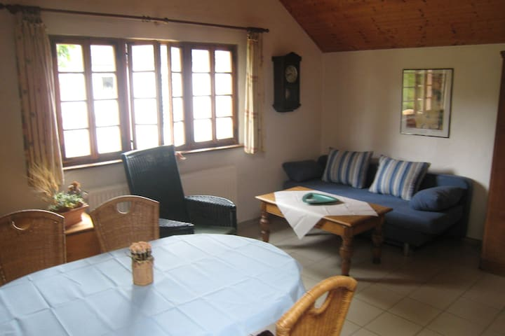 Warm apartment in a small complex with cosy beer garden and small brown cafe