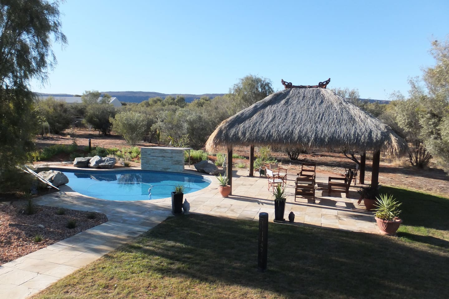 Relax in the Bali hut and enjoy  Country living In Style with large pool for your use