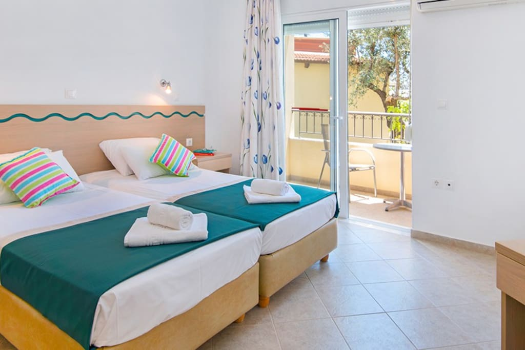 Bedroom with balcony and Air condition induced in the price