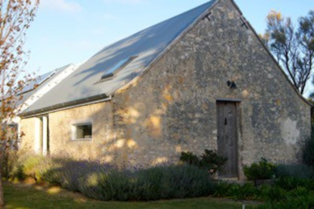 The Coach House is a restoration of an 1850s limestone farm building