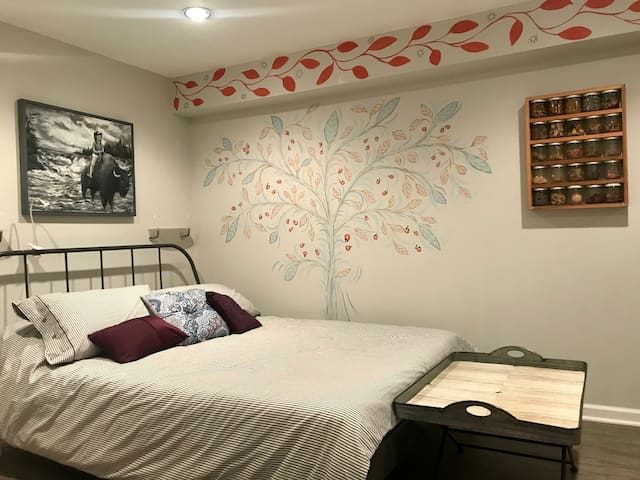 Comfy Queen Bed, Tree Mural, Painting and Glass Jar Art