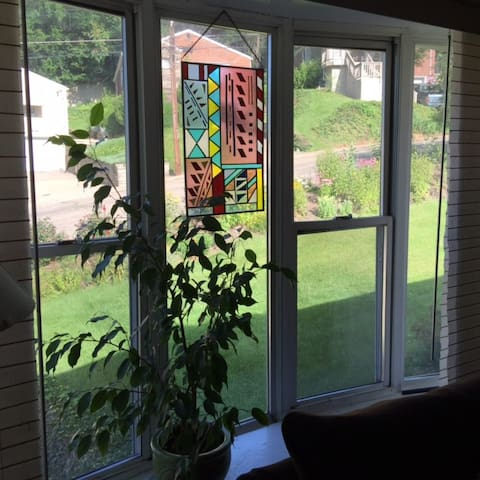 View from living room to front yard and cul de sac.