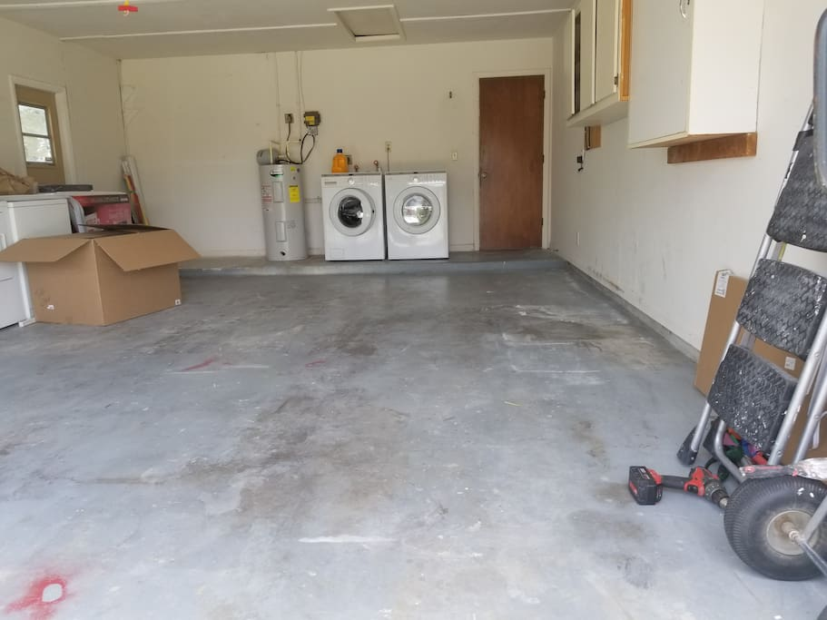 Full garage with washer and dryer