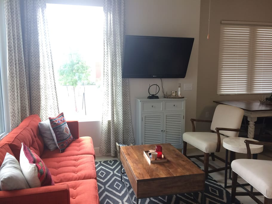 Wall-mounted tv in living room