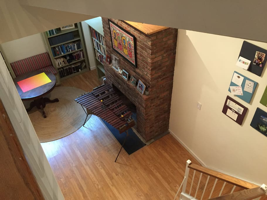 Downstairs library with fireplace - good for reading or crafting.