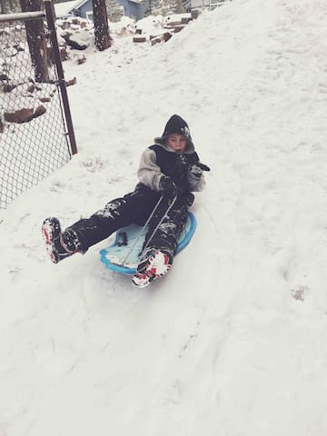 A fun sled hill right on the side of the house!