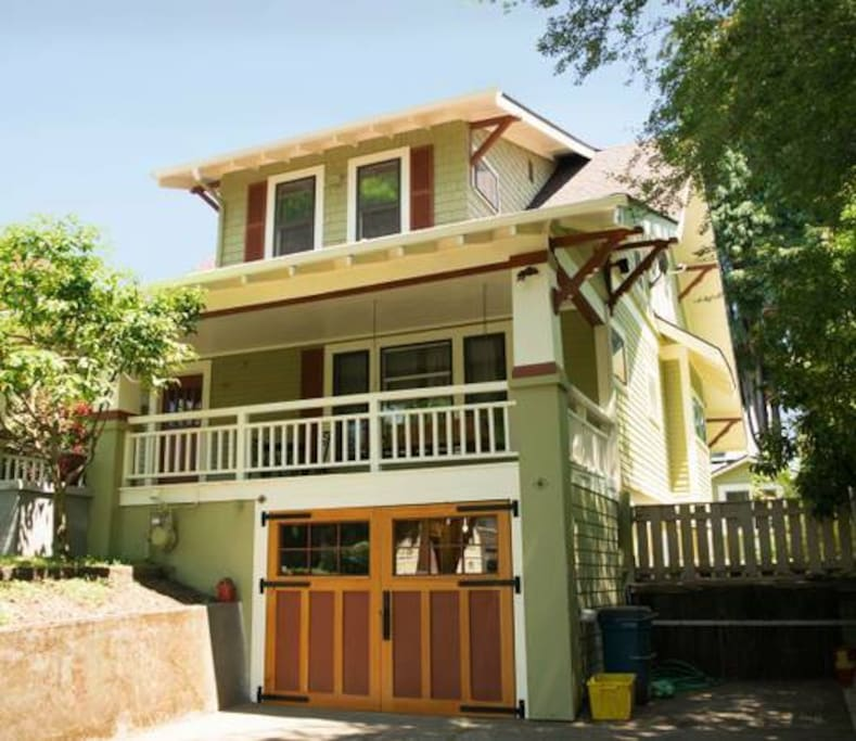 Classic craftsman bungalow with custom carriage doors on garage