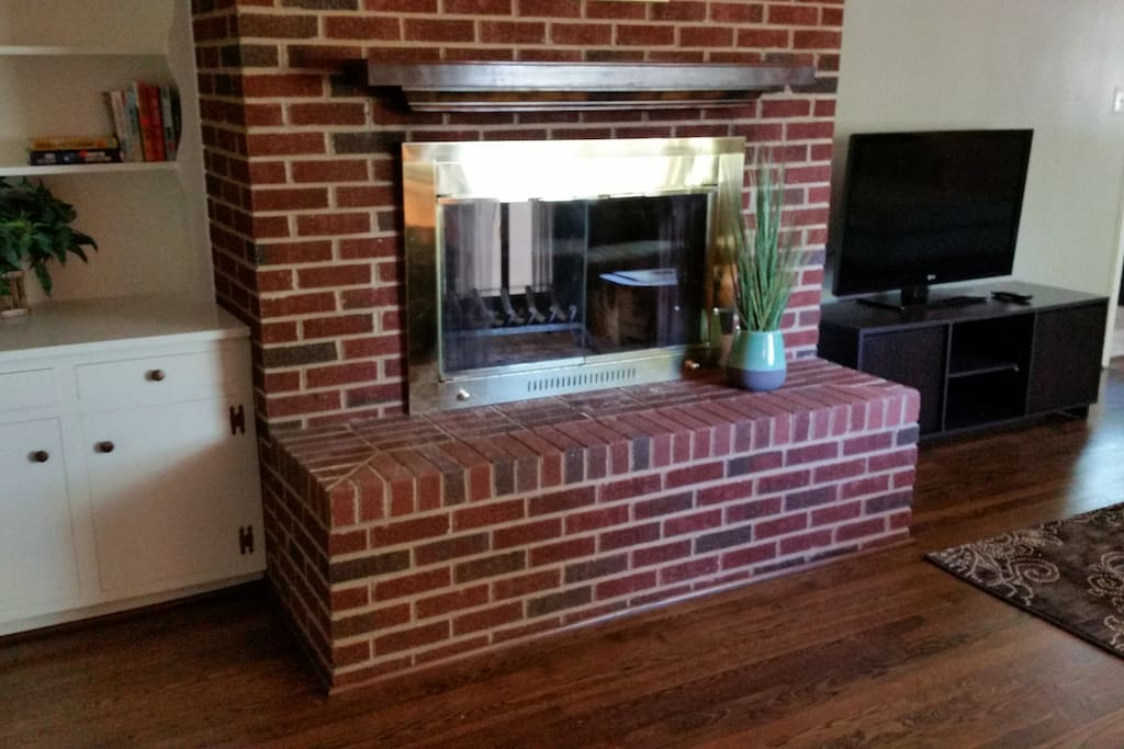 Den also includes a fireplace and large TV