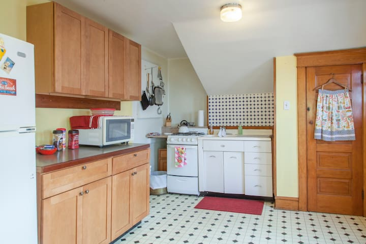 It is a combination 50's style kitchen and cozy living area with internet t.v. The kitchen is fully equipped with a full size refrigerator, microwave, and gas stove plus all cooking and eating accoutrements.