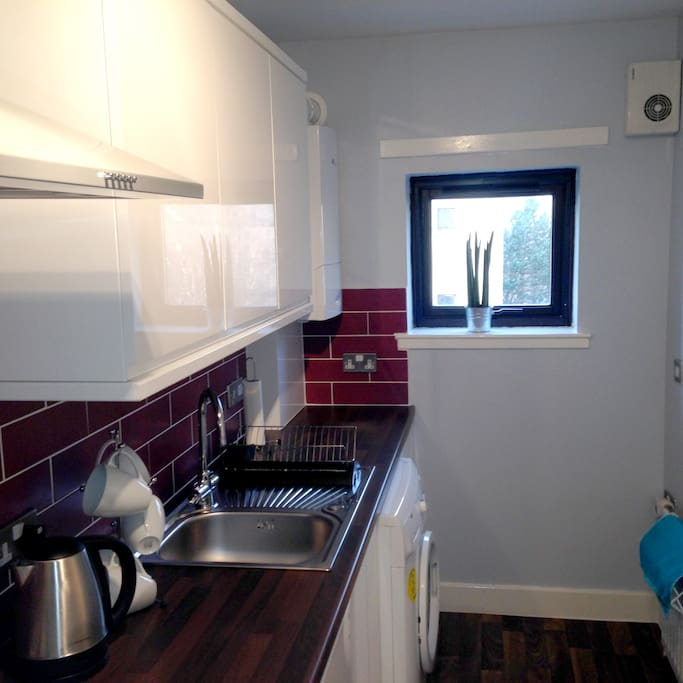 Gas Hob & Washing Machine. Separate Fridge & Freezer. Microwave, Kettle & Toaster