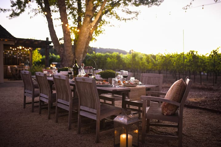 Dine al fresco under the string lights overlooking vineyards and mountains.