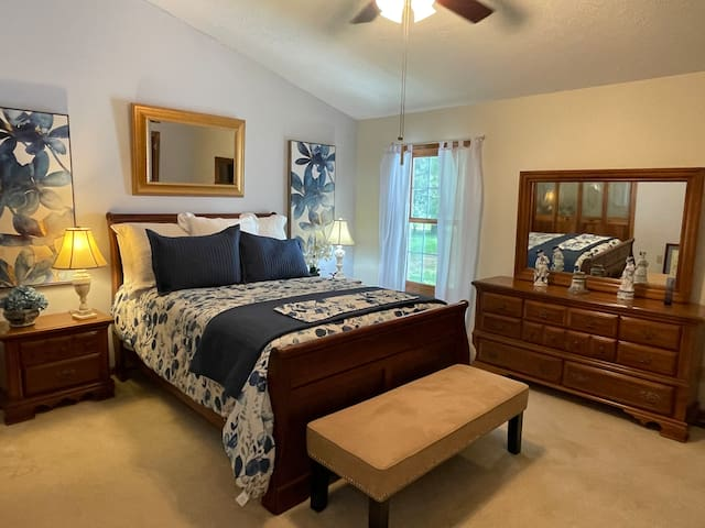 Master bedroom, with queen size bed, is attached to a large spacious bathroom with a Jacuzzi tub and a step in the shower.