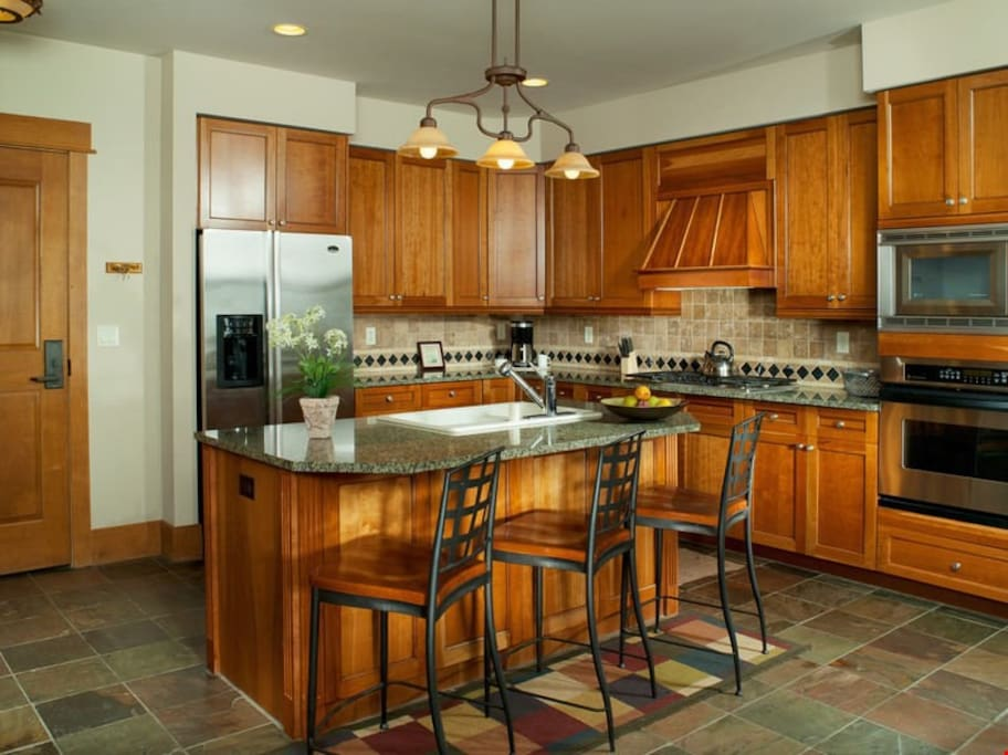There is plenty of space in the fully-equipped kitchen, complete with breakfast bar