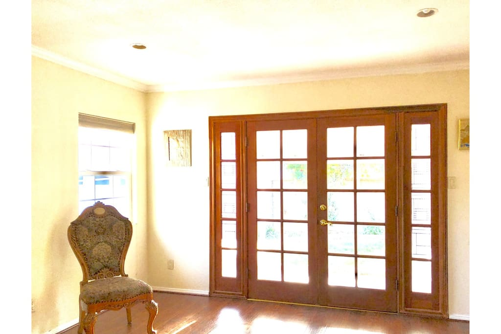 Den leads out French doors to backyard