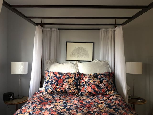 Cozy up in the romantic canopy bed
