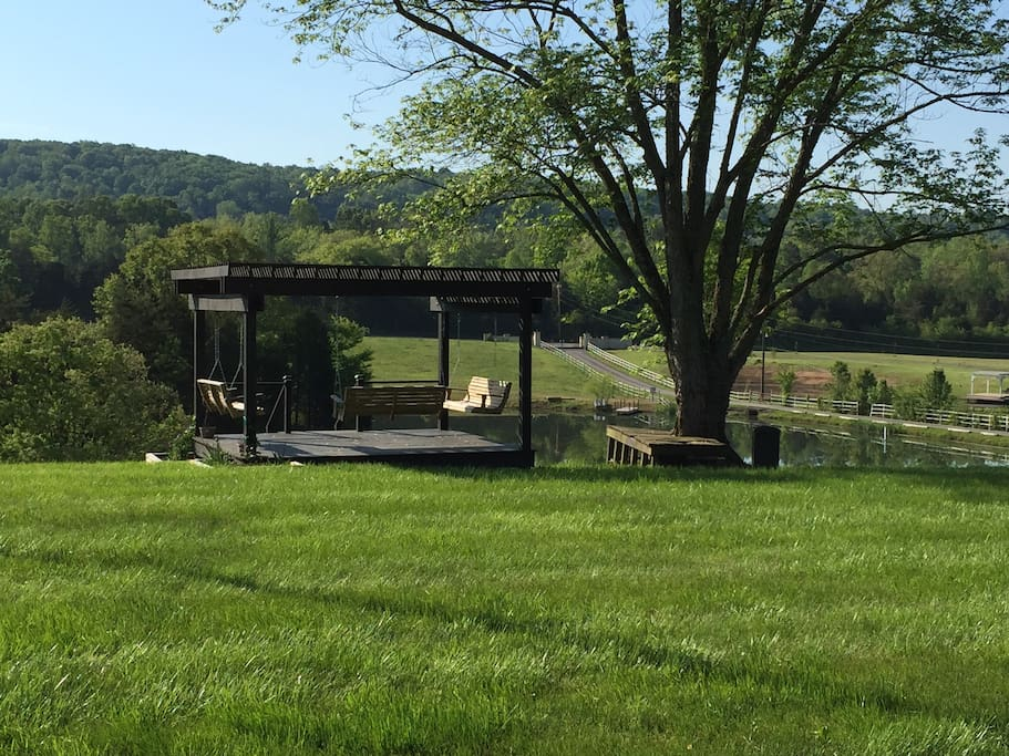 The nice pavilion with bench swings that you all can enjoy. There is also a fire pit you can use as well.