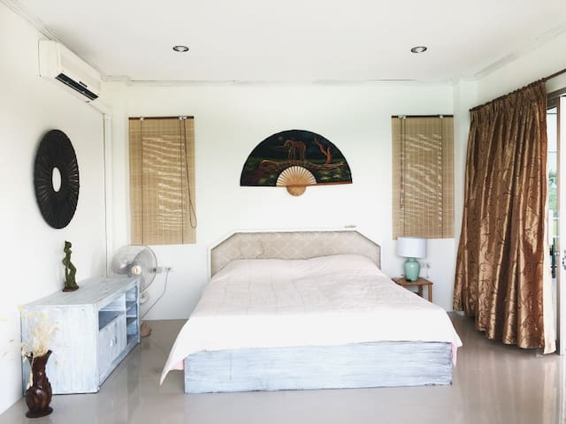The room double king-size bed and ocean views, pool access. Your Home Samui