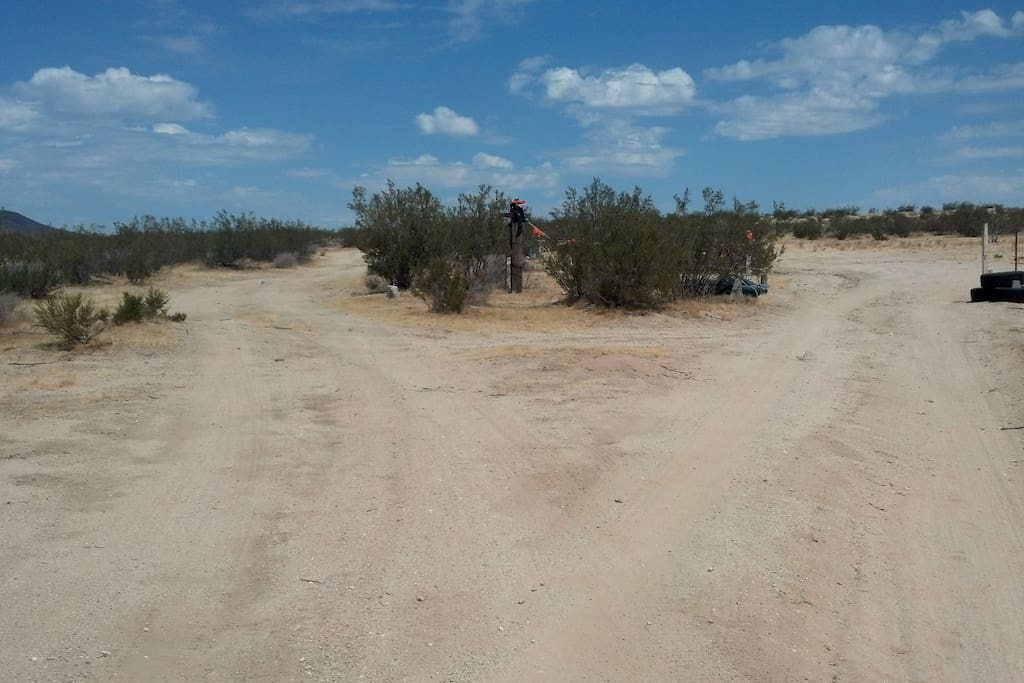 You Made It!! Made it To Our Fork in the Road!! Go Right! Right into the property. Left goes around the west side and past our back gate (your 2nd chance to enter) before disappearing into the desert. So...go right, or swing right later at the back gate. Thanks