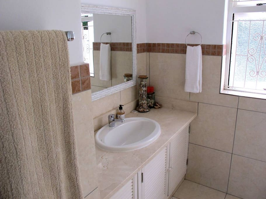 Bathroom with bath and shower over bath