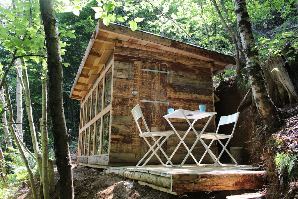 The wood cabin is new and has a modern look.
