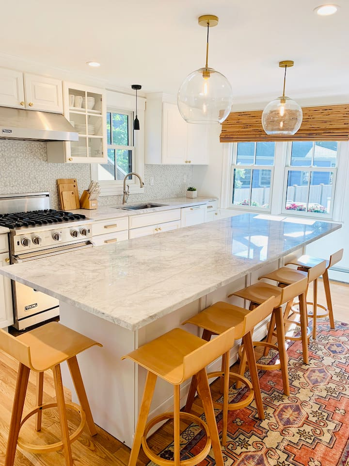 Completely renovated kitchen with Viking appliances, built-in dishwasher, disposal, and gas range. Large island is perfect for entertaining. Place settings and cookware if you'd like to cook at home. Central AC keeps things cool and dry.
