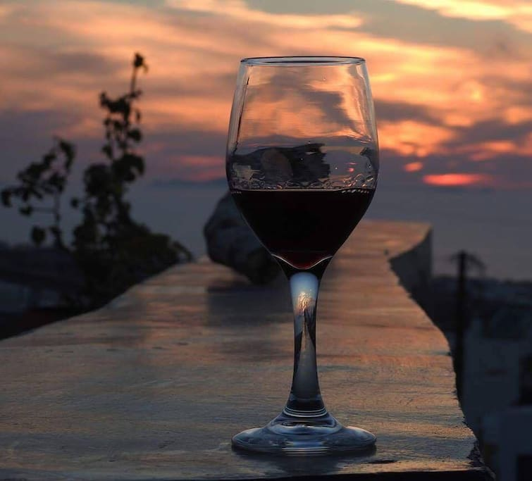 relaxing on the balcony with a glass of wine and amazing sunset.