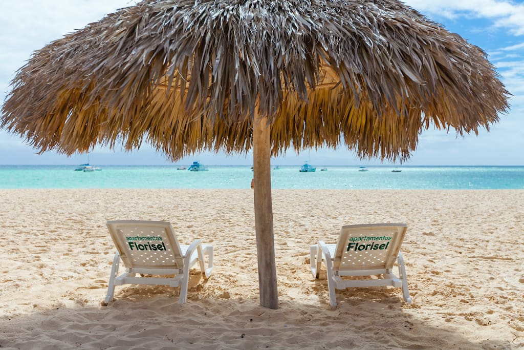 Our private beach with private beach loungers and parasols