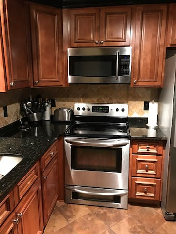Updated kitchen! Equipped with everything you need to feel at home.  Includes dishes, pots, cleaning supplies, and basic essentials.
