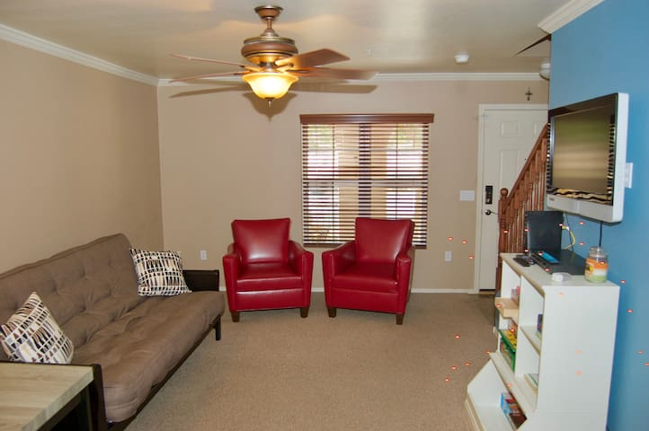 1st FL, Futon with full mattress, reading area and First FL bathroom.