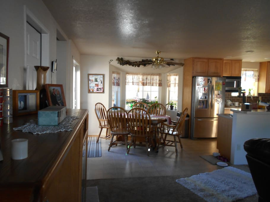 Open dining room off kitchen. Glass sliding doors to deck with outside BBQ and reager smoker with large eating area.