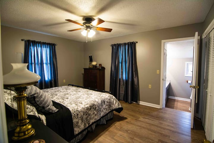 Spacious master bedroom with king bed.