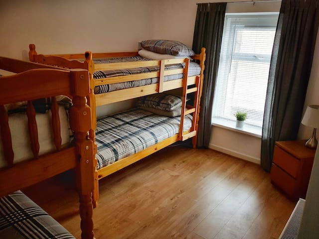 Bedroom 2 Sleeps 4 people comfortably  We have Quality mattresses on all 4 beds to give you a good nights sleep.