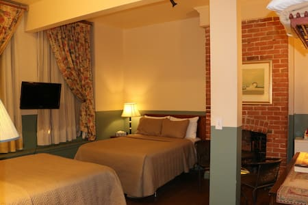 Private room with 2 double beds and a private bathroom. We have 8 of them in the property, your room might differ with the one in the picture. All rooms are relatively similar.
