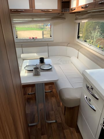 Additional table included to give second dining area to rear of vehicle.