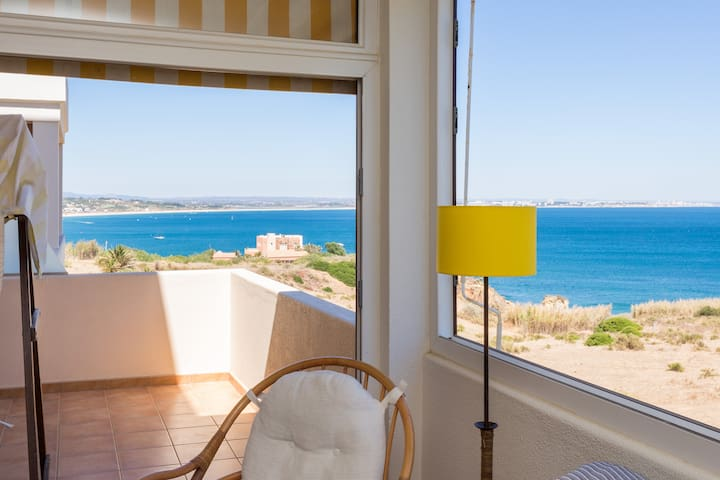 The 20 m2 terrace consists of an open part with a swing and part of a closed window with a breathtaking view of the Ocean