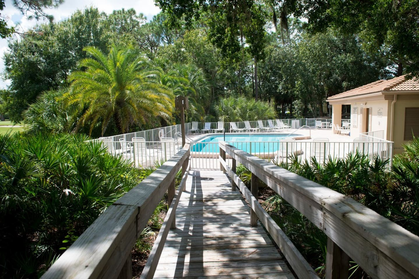 Trail to pool right behind condo!
