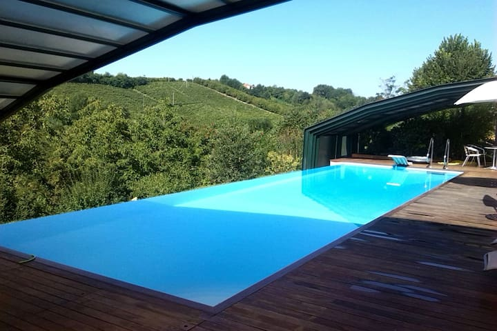 Portion of an old renovated charming house, in the countryside with heated pool