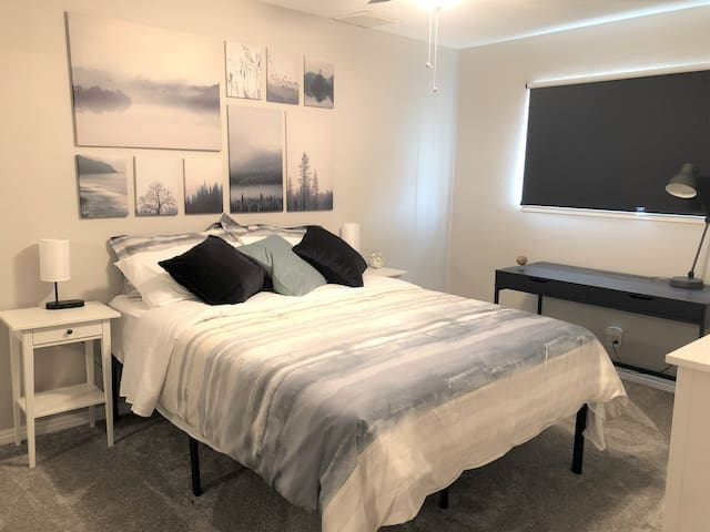 Queen Bedroom - ceiling fan, workspace desk, bedside lamps with several USB and Qi wireless charging capability