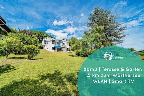 Apartmán Velden ~ Top Umiestnenie ~ Záhrada s výhľadom na vzdialenosť